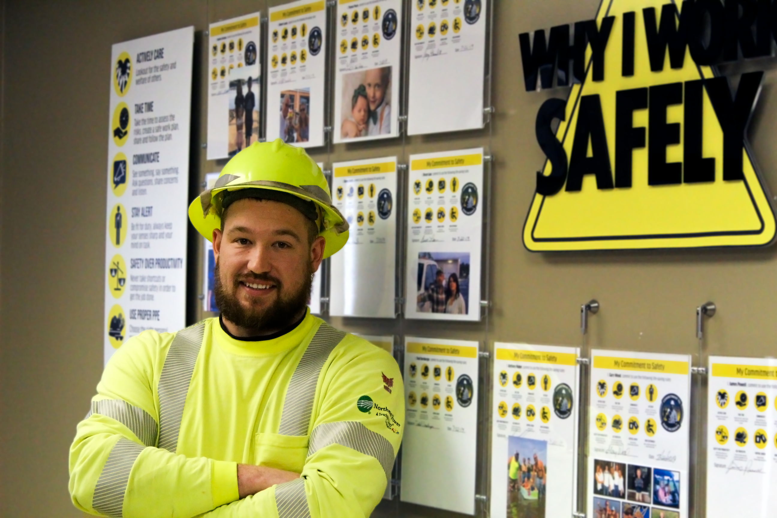 employee in front of safety wall
